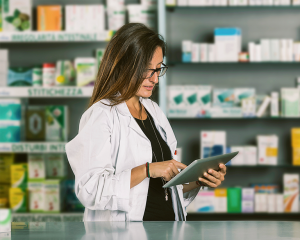 Pharmacist looking at mobile device